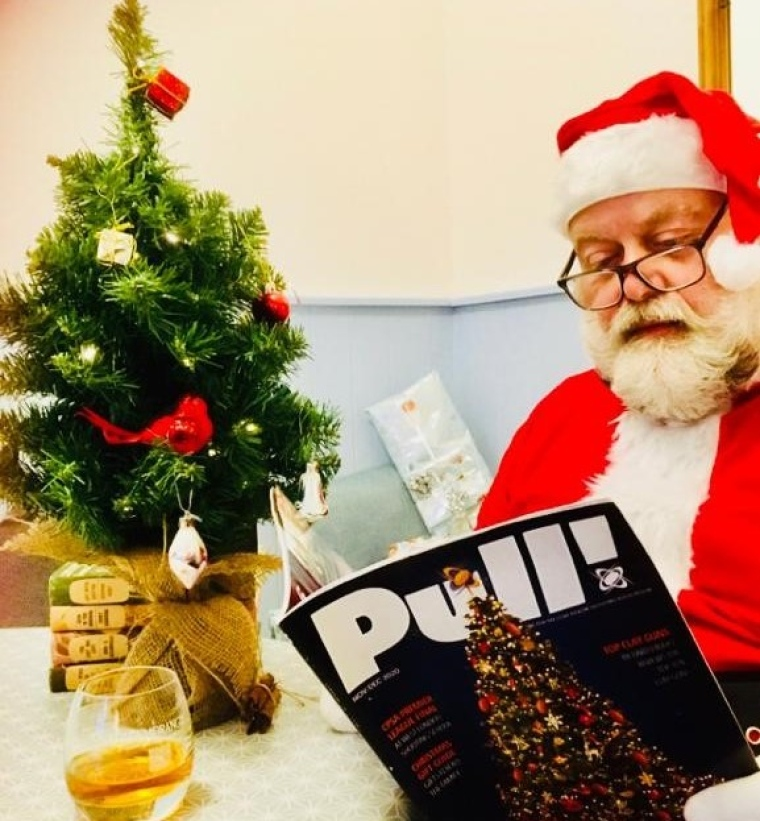 Father Christmas reading Pull! magazine